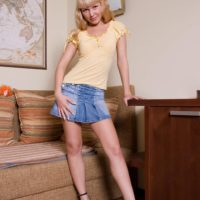 Platinum-blonde first timer finger spreads her gash while naked on a chesterfield in ankle rope stilettos