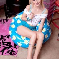 Platinum-blonde stunner Sammy Daniels slipping cut-offs over butt and legs to unsheathe panties
