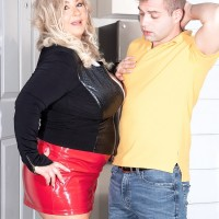 Blonde BIG SEXY LADY Amanda Remington uncorks her funbags during seduction action in a spandex mini