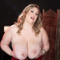 Sandy-haired BIG SEXY WOMAN Amiee Roberts plays with her large funbags after pulling them out