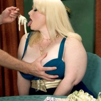 Ash-blonde BIG HOT LADY adult video starlet Dawn Davenport jerking penis while licking food and masturbating