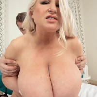 Ash-blonde BIG HOT WOMAN Samantha Sanders shows her big boobies while getting drilled on a bed