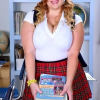 Sandy-haired BIG HOT LADY solo girl Mya Blair modelling in coed uniform, glasses and pigtails