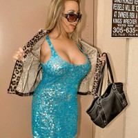 Ash-blonde sweetie Amber Lynn Bach showing off giant titties to entice younger boy