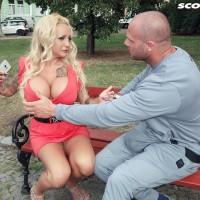 Golden-haired bombshell Bambi Blacks seduces a boy on a park bench in a short dress