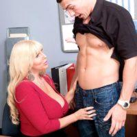 Light-haired boss doll Karen Fisher revealing humungous breasts while seducing employee