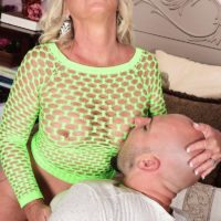 Light-haired cougar Brandi Jaimes entices a stud in a see thru fishnet dress and stilettos