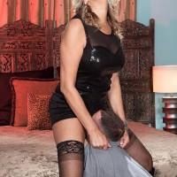Platinum-blonde cougar Dallas Matthews has her vag fellated after seducing a junior dude