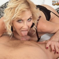 Yellow-haired cougar Molly Maracas gobbles her junior lover's dick after he brings her wine