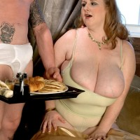 Blonde feeder Sapphire whipping out big titties before providing hand-job while sucking