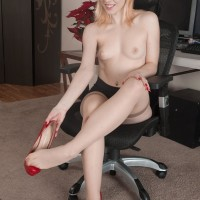 Blonde first timer in micro-skirt rolling hosiery over gorgeous pins and feet before slit spread