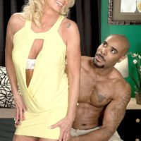 Blond grannie Nikki Chevious works on seducing a ebony stud in a yellow sundress