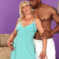 Yellow-haired granny Andi Roxxx tongue kisses a black dude before having her cunt blown