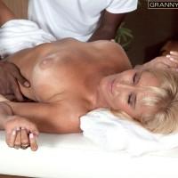 Blond granny Brittney Snow gets seduced by her ebony massage therapist