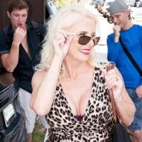 Ash-blonde grandma Cammille Austin masturbates a pair of cocks after seducing studs in a dress