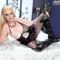 Platinum-blonde granny Charlie exposes her big boobs in over the knee boots and mesh body-stocking