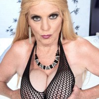 Yellow-haired grandma Charlie whips out her big hooters in over the knee boots and mesh bodystocking