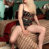 Platinum-blonde grannie Jennifer Janes has her breasts and cunny exposed by her ebony lover