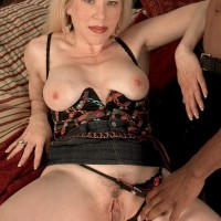Platinum-blonde grandmother Jennifer Janes has her boobies fumbled while being undressed by a black dude