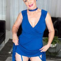 Blond grandma with short hair Seka Ebony strips to tan tights adorned a choker