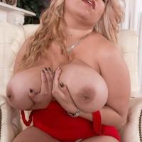 Blonde Latina MILF Nancy Navarro unveiling huge natural tits in stilettos