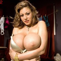 Ash-blonde MILF Crystal Gunns revealing humungous boobies in hose and high heeled shoes