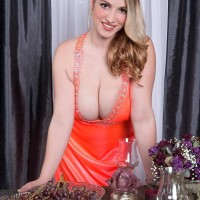 Ash-blonde MILF Melissa Manning flashing up micro-skirt panties before exposing huge melons