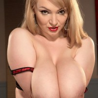 Fair-haired MILF Micky Bells deep throats on her own nips while holding her giant boobies