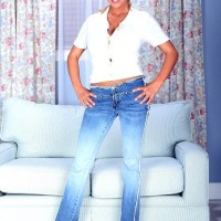 Golden-haired MILF adult film starlet Autumn Jade revealing enormous fun bags while getting rid of jeans