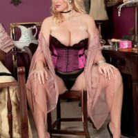 Golden-haired MILF Rockell extracts her humungous titties in foxy lingerie before donning hose