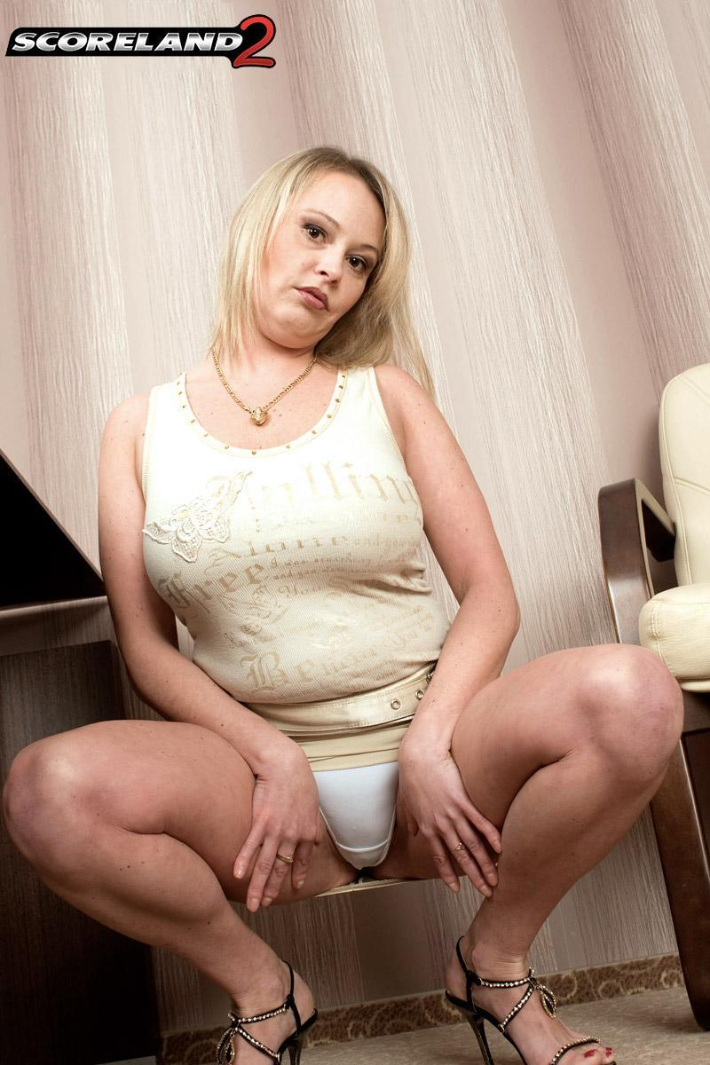 Blonde MILF Vanessa Lilio flaunting upskirt panties before revealing huge juggs