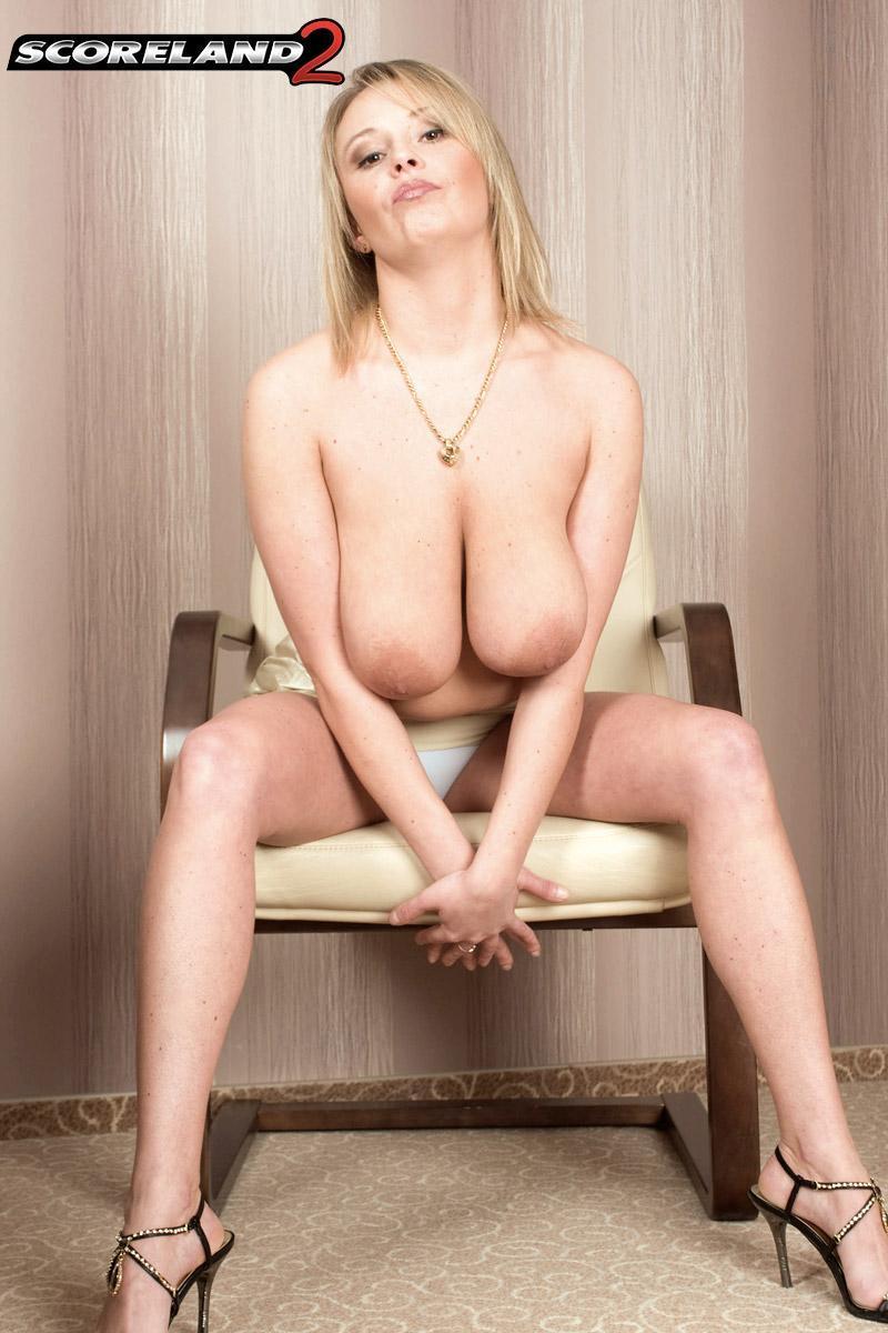 Blonde MILF Vanessa Lilio flaunting upskirt panties before revealing huge juggs