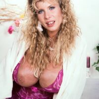 Light-haired MILF with fine legs Lynden Johnson sets forward her massive melons in solo action