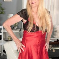 Platinum-blonde Nan Charlie tempts a junior dude in lingerie and ebony stockings