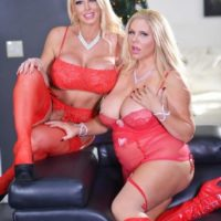 Yellow-haired XXX pornstar Karen Fisher hold her girlfriend's hooters during a pop-shot on breasts