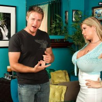 Golden-haired assistant Summer Sinn displays her big breasts at the work environment in a lengthy micro-skirt