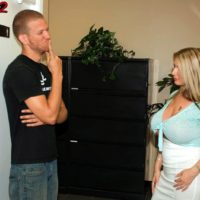Fair-haired assistant Summer Sinn shows her humungous knockers at the work place in a long microskirt