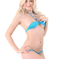 Golden-haired solo chick Nika N peels off her bikini preceding to frigging her trimmed gash