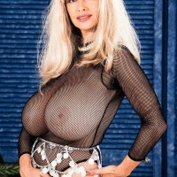 Light-haired solo model Alexis Enjoy holds her hefty fun bags after unleashing them from see thru top