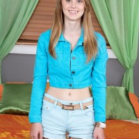 Blond nubile Lily Rader unsheathing tiny boobs and undies after denim cut-offs removal