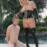 Ash-blonde mistress Ashley Edmunds puts her subby hubby in a cage during a instructing session