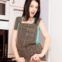 Boots garbed dark haired amateur Lolly exposing petite nubile funbags and wonderful derriere in kitchen
