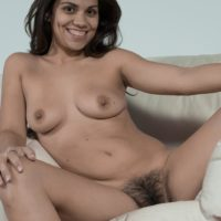 Dark-haired first timer Camille S showing off small breasts before spreading fur covered pussy