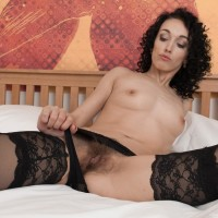 Dark haired amateur Cleo Wish unveiling fantastic legs from stockings before spreading pussy
