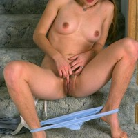 Dark-haired amateur exposing fur covered armpits and hairy snatch while undressing