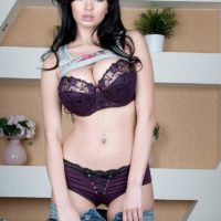 Brunette stunner Sha Rizel letting out enormous natural juggs from purple lingerie