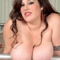 Brown-haired BBW Angel Sin sucks on a sex toy and erect nipples after peeling off sexy lingerie