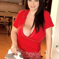 Dark-haired BIG BEAUTIFUL WOMAN Joana Bliss licks a nipple after baring her large breasts in solo act
