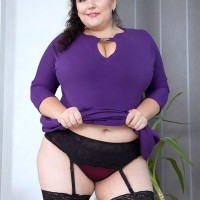 Dark haired BIG SEXY LADY Mariya Mills letting enormous saggy boobies free from sundress and boulder-holder in nylons