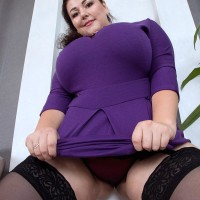 Brown-haired BIG SEXY LADY Mariya Mills letting gigantic floppy hooters loose from dress and melon-holder in hosiery